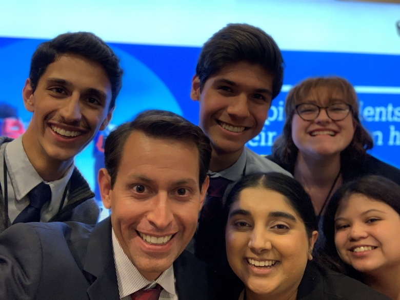 Youth Advisory Council panelists pose for a selfie with College Board's Edward Biedermann.
