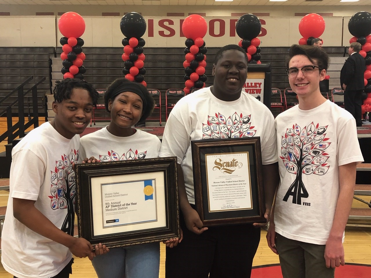 Moreno Valley students holding awards